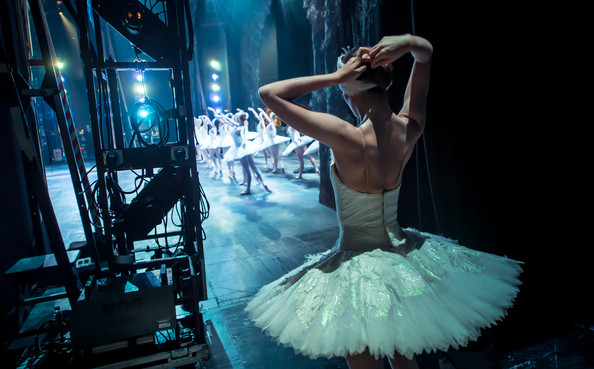 Photo by: Ian Gavan of Ellie Sharpe of the English National Ballet prepare in the wings during a dress rehearsal of Swan Lake at the Coliseum on August 3, 2012 in London, England.